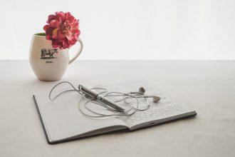 journal, headphones, and mug